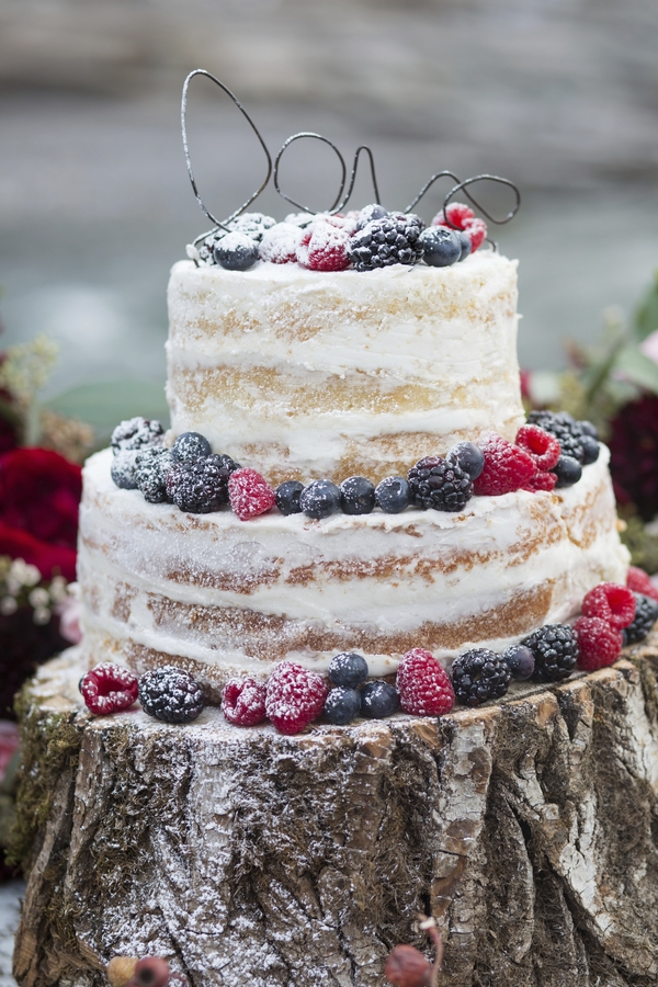 Red and blue raspberry topped wedding cake Blush Rocky Mountain Wedding - Melanie Bennett Photography