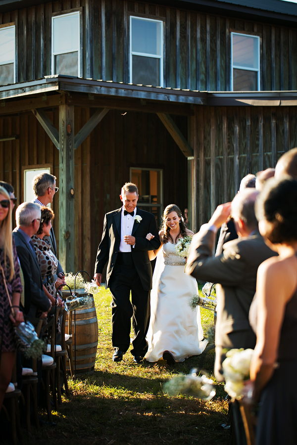 Gorgeous photo of bride walking down the aisle / Rustic Folk Weddings