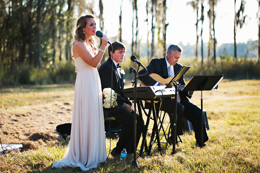 Musicians singing at rustic wedding / Rustic Folk Wedding